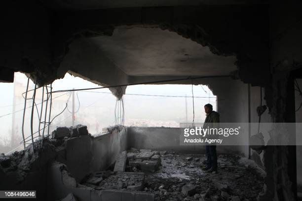 Palestinians inspect the damage after Israeli security forces blew up the family home of 16yearold Palestinian prisoner Khalil Jabbarin in Yatta town...