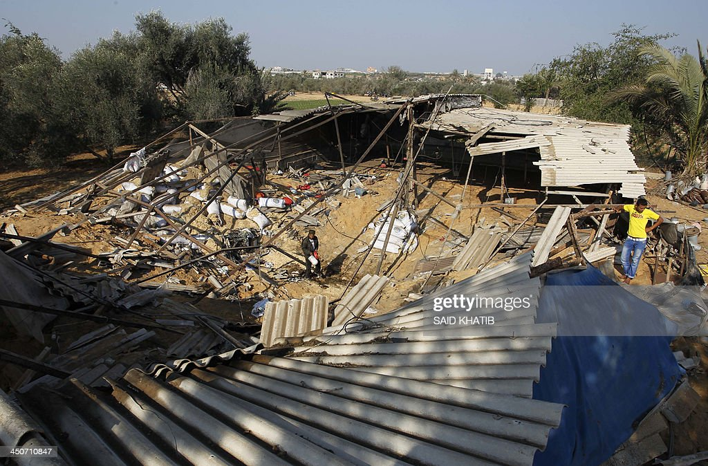 Palestinians inspect the damage in a chicken farm after it was targeted in an overnight Israeli air strike in Khan Yunis in the southern Gaza Strip on November 20, 2013. Israel carried out four air strikes on the Gaza Strip in retaliation for rocket fire against southern Israel, an army spokesman said. There were no immediate reports of casualties, Palestinian medics and witnesses said.