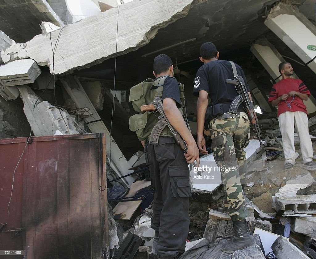 Palestinians inspect the damage to Hamas lawamker Mariam Farhat's house, after it was destroyed by an Israeli missile October 11, 2006 in Gaza, Gaza Strip. The well-known lawmaker's house was struck in what the army said was an attack on a weapons factory.