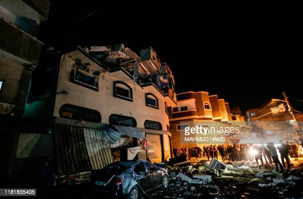 TOPSHOT Palestinians inspect the damaged house of Islamic Jihad leader Baha Abu AlAta afther an Israeli attack in Gaza city on November 12 2019...