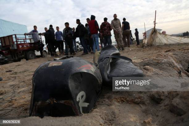 Palestinians inspect the damaged remains of a motorcycle that was reportedly hit by an Israeli strike according to the Palestinian health ministry...