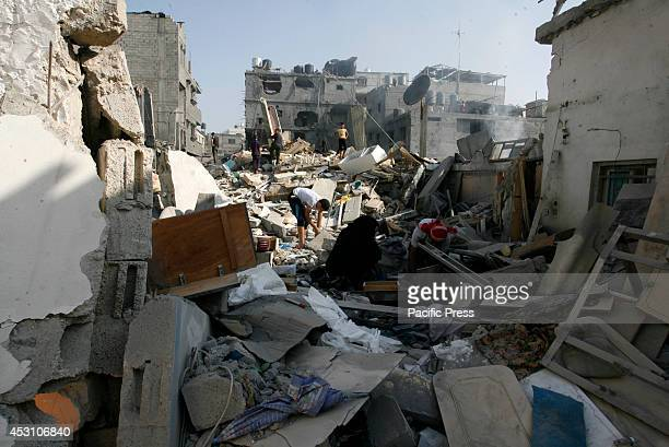 Palestinians inspect the debris of a house which witnesses said was hit in an Israeli air strike in Rafah in the southern Gaza Strip A fresh wave of...