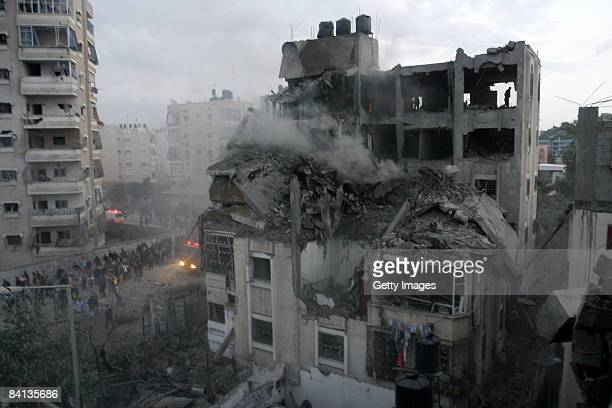 Palestinians inspect the destroyed home of a Hamas military leader after an Israeli missile strike on December 29 2008 in Beit Lahia Gaza Strip...