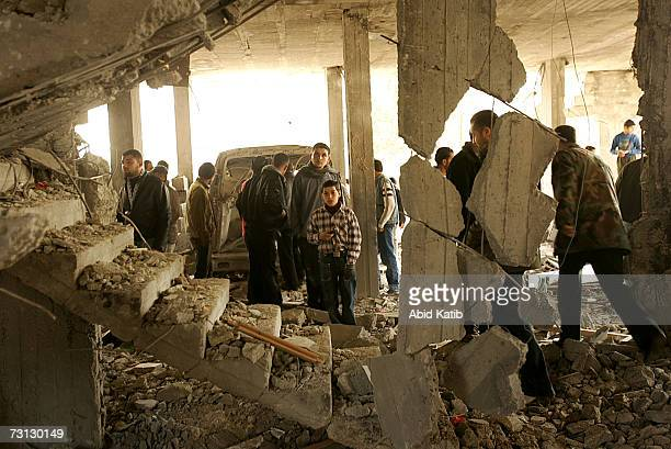 Palestinians inspect the destroyed house of a senior Fatah leader after clashes between the ruling Hamas movement and president Mahmud Abbas's Fatah...