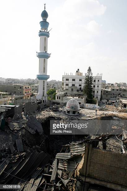 Palestinians inspect the destruction in Farouq Mosque after an Israeli air strike, in Rafah at the Southern Gaza Strip. The Israeli army warns...
