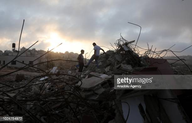 Palestinians inspect the home of Muhammad Tarek Ibrahim Dar Yusuf who allegedly killed a settler in a stabbing attack after it was brought down by...