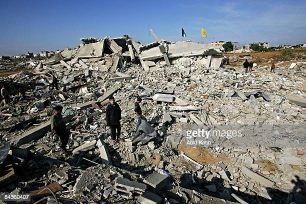 Palestinians inspect the remains of their homes destroyed by Israeli airstrikes on January 19, 2009 in Jabalia, Gaza Strip. While tensions remain...
