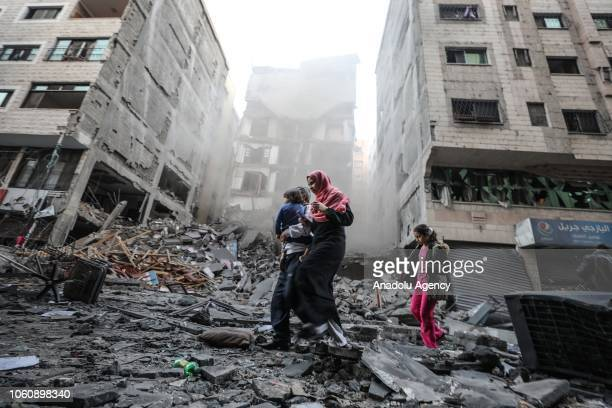 Palestinians inspect the rubble of a building after it was targeted by Israeli airstrikes against Gaza in Gaza City on November 13 2018