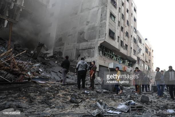 Palestinians inspect the rubble of a building after it was targeted by Israeli airstrikes against Gaza, in Gaza City on November 13, 2018 .