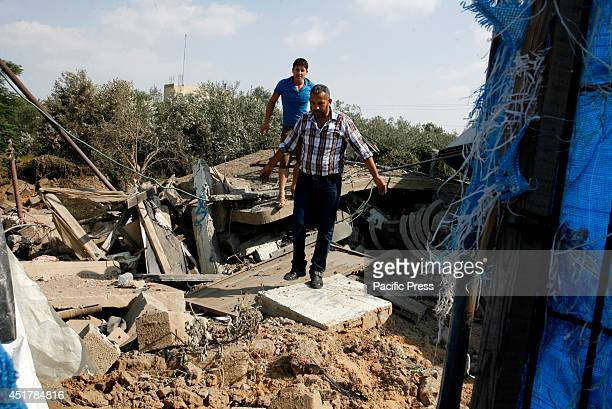 Palestinians inspect the rubble of a destroyed building following an Israeli air strike in Rafah, southern Gaza Strip. Israeli aircraft attacked 10...