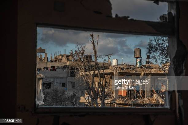 Palestinians inspect the rubble of their destroyed houses after a ceasefire between Israel and Gaza fighters, in Beit Hanun, northern Gaza Strip, on...
