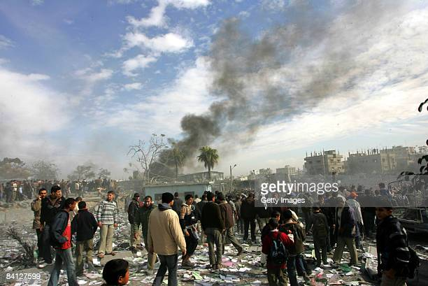 Palestinians inspect the site of an Israeli air strike in the southern town of Rafah on December 27, 2008 in Gaza. Israel's air force fired about 30...