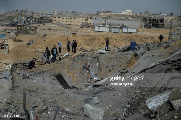 Palestinians inspect the wreckage of a collapsed building after Israeli airstrikes hit Izz adDin alQassam Brigades Izz adDin alQassam Brigades which...