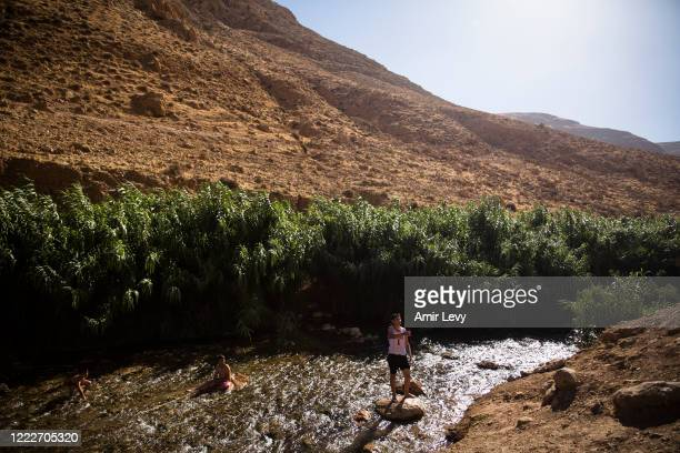 Palestinians kids hang out in the water of the natural spring of EIn AL-Auja on June 24, 2020 in Ein Al-Auja, West Bank. Israeli Prime Minister...