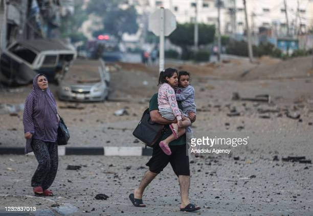Palestinians leave their neighbourhood to head to a safer location as Israeli warplanes continue air strikes on Gaza Strip, in Gaza City, Gaza on May...
