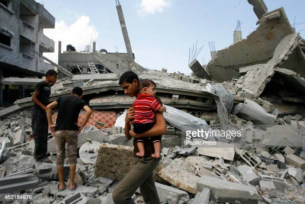 Palestinians leave their neighbourhood to head to a safer location as Israel's army continued to shell the area of Rafah, in the southern Gaza Strip....