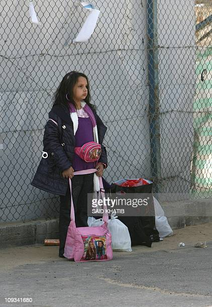 Palestinians leaving the blockaded Gaza Strip prepare to cross the Rafah border crossing with Egypt in southern Gaza on February 22 2011 after it was...