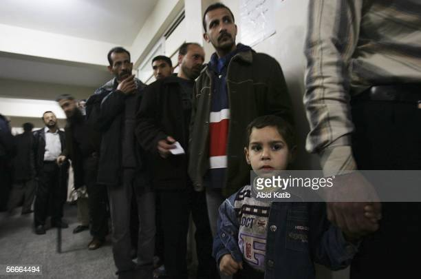 Palestinians lineup to cast their votes in the legislative elections at a polling station January 25 in Gaza City Gaza Strip The newly elected...