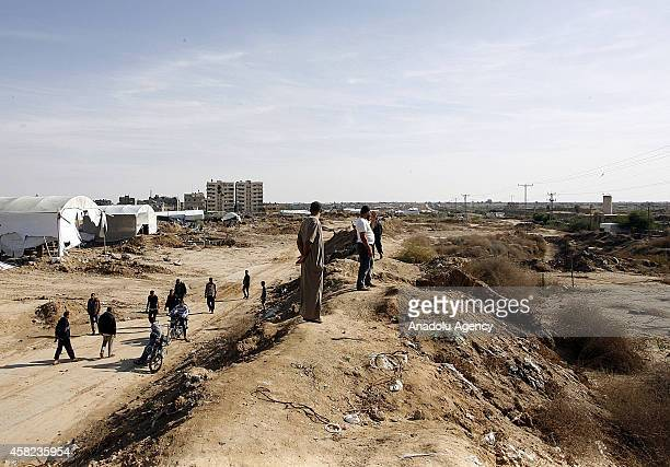 Palestinians living in Rafah are seen at the border as Egyptian army blows up buildings as part of an operation aiming to create a buffer zone at the...