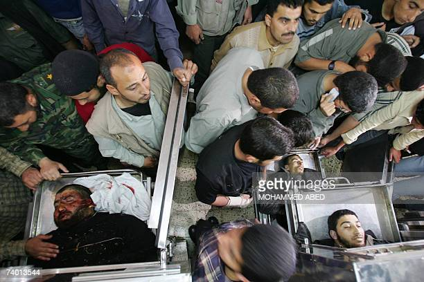 Palestinians look at the bodies of three dead Palestinians in Gaza city hospital 28 April 2007 Israeli troops shot dead three Palestinians and...