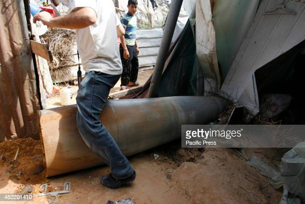 Palestinians look at the rocket hit by Zionist warplanes that did not explode in the home of citizens east of Rafah in southern Gaza Strip. The death...