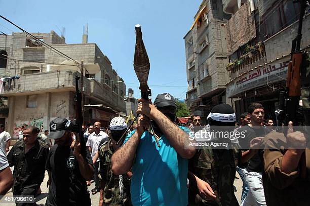 Palestinians march during funeral of Palestinian Marwan Sleem in the central Gaza Strip Gaza on July 7 2014 Israeli airstrikes aiming Gaza leave 9...