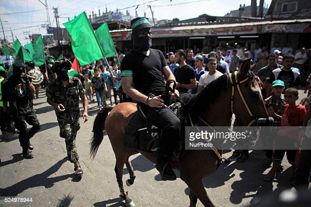 Palestinians masked of Hamas take part in a rally marking 13th anniversary of the socalled AlAqsa uprising or 'Second Intifada' and against visits to...