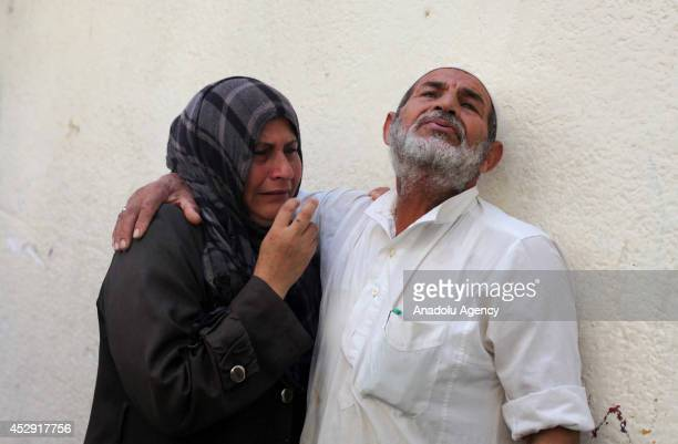 Palestinians mourn after an Israeli strike on a UN-run school, in Beit Lahia, Gaza on July 30, 2014. The death toll from the Israeli shelling of a...