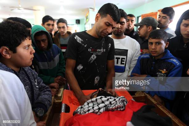 CONTENT Palestinians mourn and peer over the body of activist Ibrahim Abu Thuraya who was shot dead by Israeli troops on Friday during clashes...