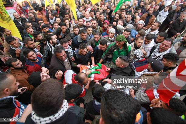 Palestinians mourn around the dead body of 16yearold Ali Amr Qino who was killed in clashes with the Israeli army that erupted in the village of...