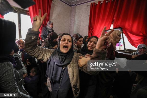 Palestinians mourn during funeral of Hassan Nabil Nofal who was hit in the head by an Israeli teargas bomb last Friday in the Bureij refugee camp and...
