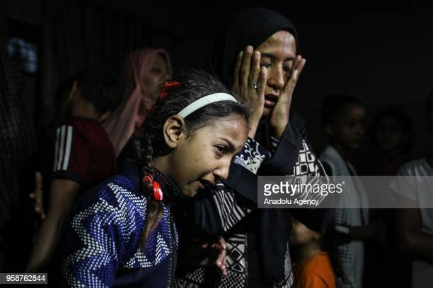 Palestinians mourn during the funeral ceremony of eightmonthold Palestinian baby Leila Anwar Ghandoour died from tear gas inhalation during clashes...