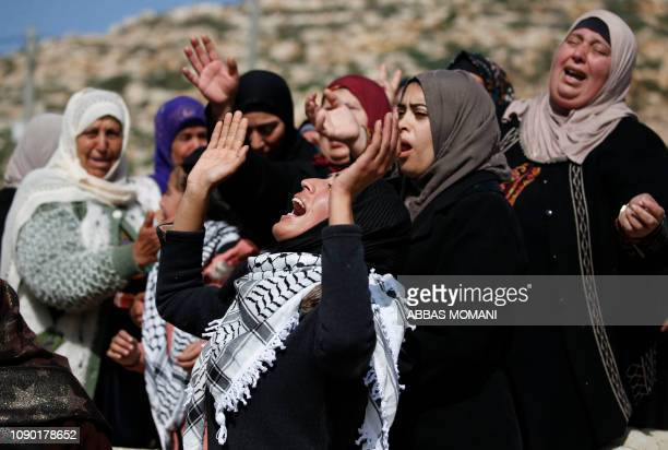 Palestinians mourn during the funeral of Hamdi Nassan in the village of Mughayir in the Israelioccupied West Bank on January 27 2019 The Palestinian...