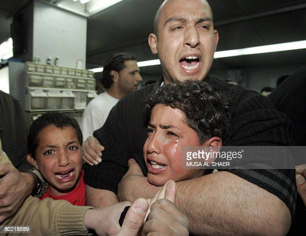 Palestinians mourn the death of a relative killed by Israeli undercover forces in the West Bank town of Bethlehem on March 12 2008 Israeli undercover...