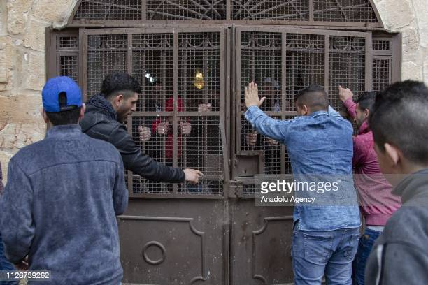 Palestinians open the door of the AlRahma Gate to perform Friday prayer at AlAqsa Mosque Compound after the continued closure by Israeli police in...