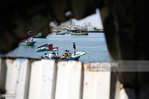 Palestinians organized boat parade with flags during a rally marking the 5th anniversary of the Mavi Marmara Gaza flotilla incident at the seaport of...