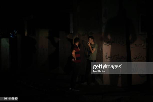 Palestinians outside their homes during power cut at AlShati refugee camp in Gaza City August 27 2019