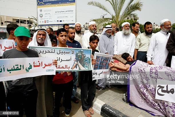 Palestinians participate during a rally in Rafah in the southern Gaza Strip to show solidarity with Palestinian prisoners held in Israeli jails About...