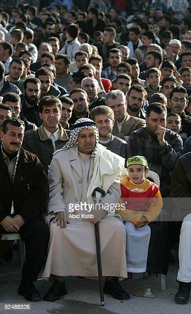 Palestinians participate in a proelection rally organized by the Fatah movement March 28 2005 in the Beit Lahyea Refugee Camp near the Israeli...