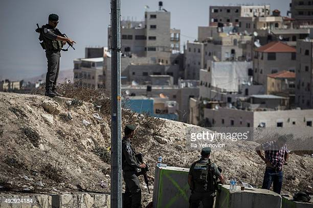 Palestinians pass a checkpoint in Issawia neighbourhood on October 16 2015 in Jerusalem Israel As violence continues to break out in the West Bank...
