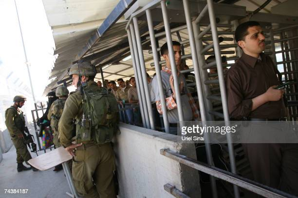 Palestinians pass through the Hawarra checkpoint on June 3 near the West Bank city of Nablus, West Bank. Palestinians will mark forty years of...