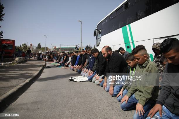 Palestinians perform a Friday Prayer to protest Israeli authorities' mass retribution enforcements at the entrance of Iseviye neighborhood of East...