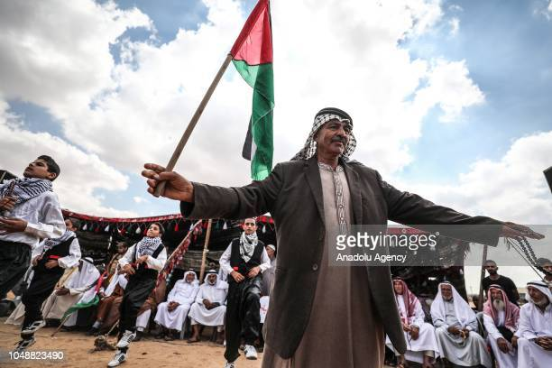 "Palestinians perform a traditional folk dance called 'Dabke' at the ""Great March of Return"" demonstration area during an event, based on Palestinian..."