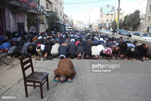 Palestinians perform Friday Prayer as they gather to stage a protest against US President Donald Trumps announcement to recognize Jerusalem as the...