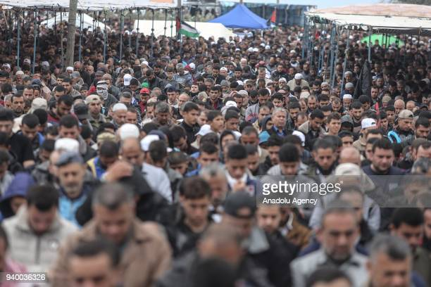 Palestinians perform Friday Prayer during the 'Great Return March' in Gaza City Gaza on March 30 2018 Dubbed the Great Return March Fridays rallies...