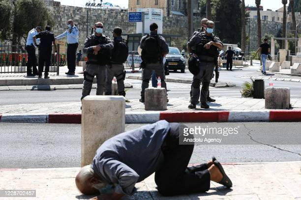 Palestinians perform Friday prayer in front of Damascus Gate as Israeli security forces do not let Palestinians enter Al-Aqsa Mosque by taking...