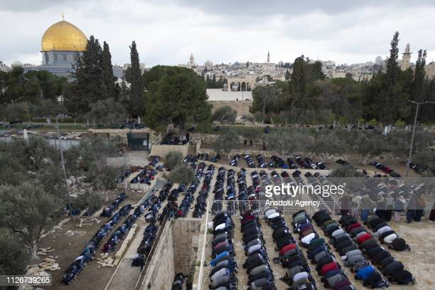 Palestinians perform Friday prayer inside the AlRahma Gate at AlAqsa Mosque Compound after the continued closure by Israeli police in Jerusalem on...