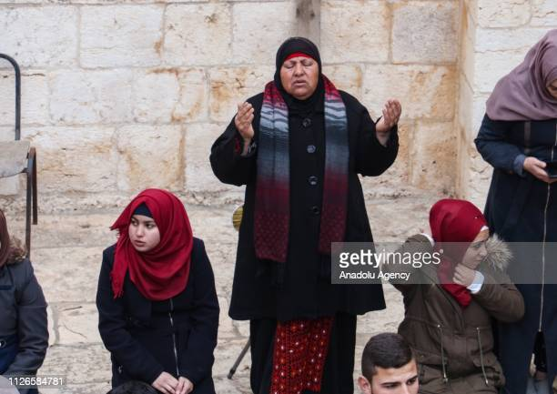 Palestinians perform morning noon and afternoon prayers in front of AlRahma Gate of AlAqsa Mosque Compound after it was chained by Israeli police in...