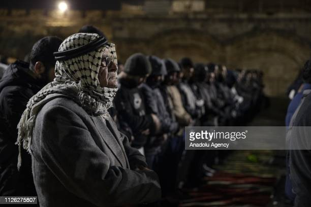Palestinians perform prayer in front of AlRahma Gate of AlAqsa Mosque Compound after it was chained by Israeli police in Jerusalem on February 20 2019