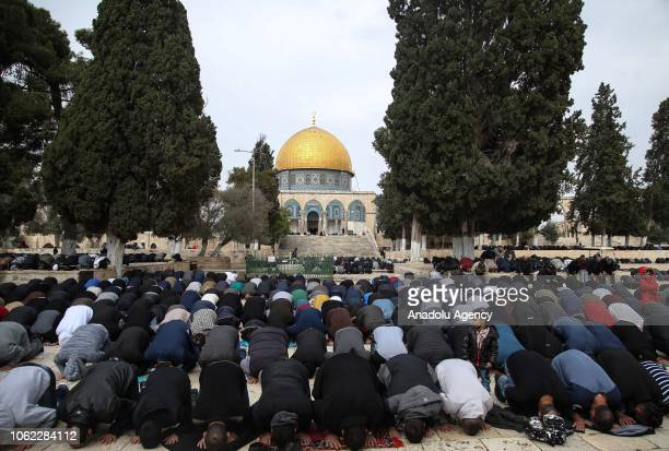 Palestinians perform the Friday prayer at AlAqsa Mosque Compound in Jerusalem on November 16 2018 According to Islamic belief Al Aqsa Mosque is the...